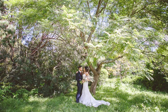Bride and groom in gorgeous garden