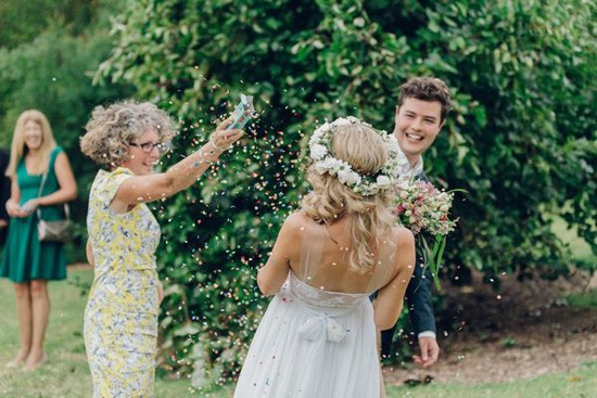Bride being showered with rose petals