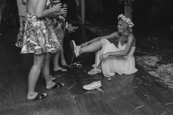 Bride changing into sneakers