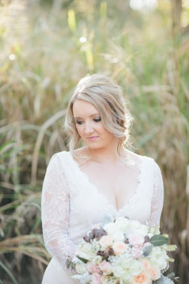 Bride in v neck wedding dress