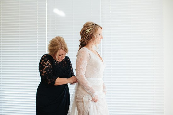 Bride putting gown on