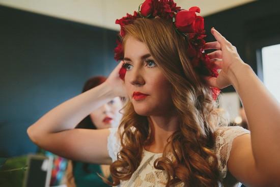 Bride putting on flower crown