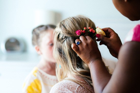 Brides flower filled hairstyle