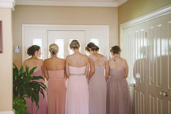 Bridesmaids in different pink dresses