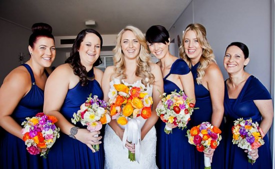 Bridesmaids in navy with poppies
