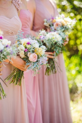 Bridesmaids in pink with coloured bouquets