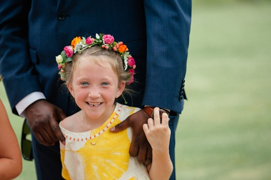 Flowergirl in bright yellow dress with flower crown