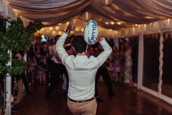 Football toss at wedding