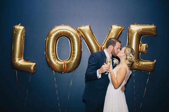 Gold foil love letters at wedding