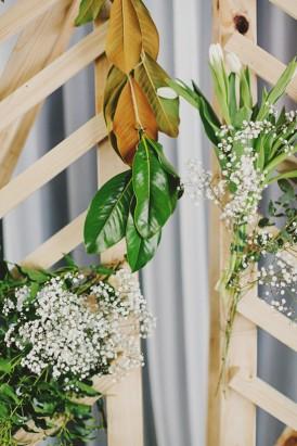 Greenery on wedding ceremony backdrop