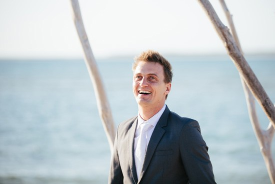 Groom at beach wedding