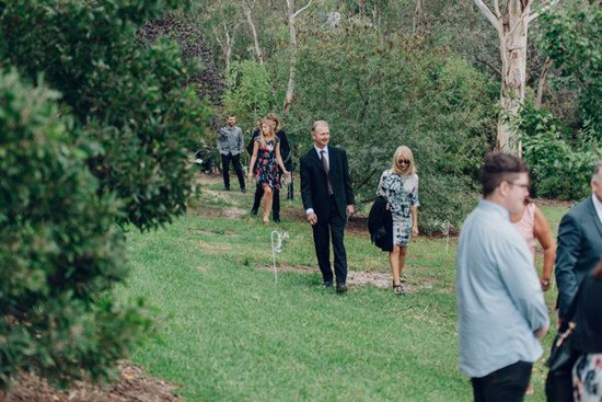 Guests arriving at backayrd ceremony