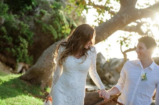 Island bride with long sleeve wedding dress