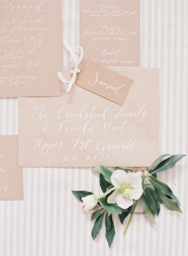 Kraft wedding invitation with white ink