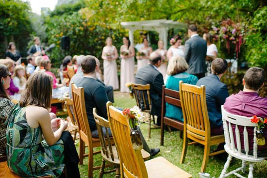 Mismmatched chairs at wedding ceremony