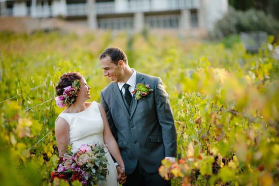 Newlyweds in Autumn vineyard