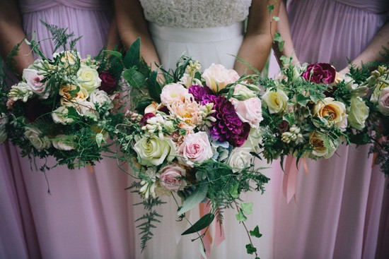 Pink and magenta bouquets with greenery