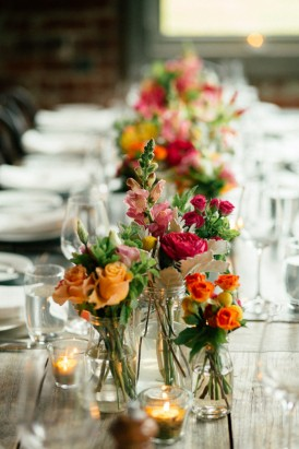 Red and orange wedding table flowers