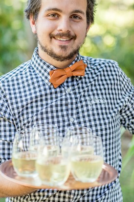 Waiter with Gingham Shirt and Champagne