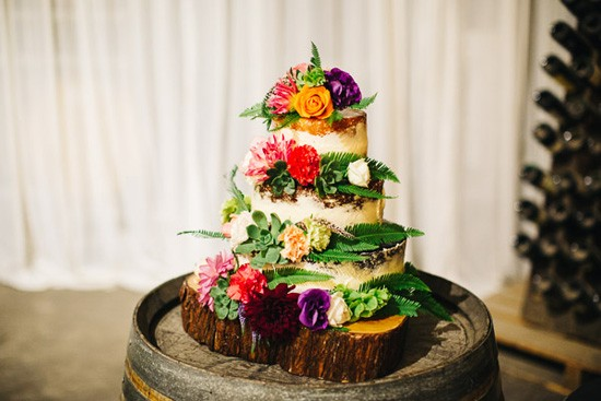 Wedding cake with lots of bright flowers