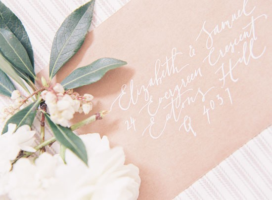 White calligraphy wedding envelope