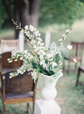 White floral arrangement at outdoor ceremony