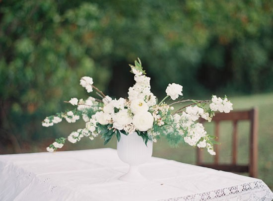 White vase with white flowers at wedding