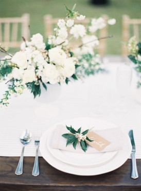 White wedding table with greenery