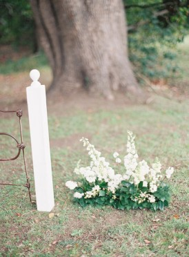 White with green wedding ceremony flowers