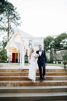 Bride and groom entering through door