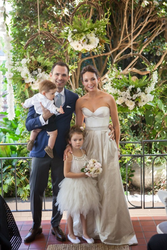 Bride and groom with children after ceremony