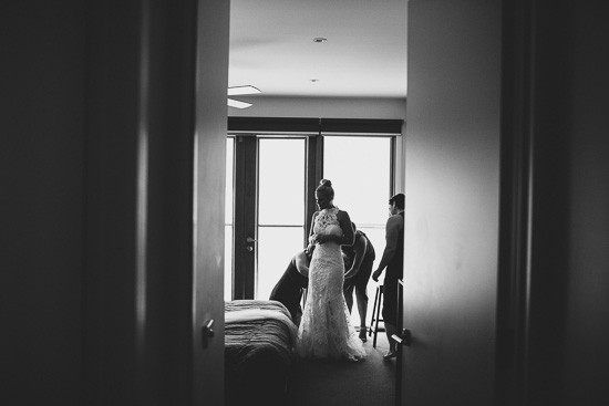 Bride getting dressed photo