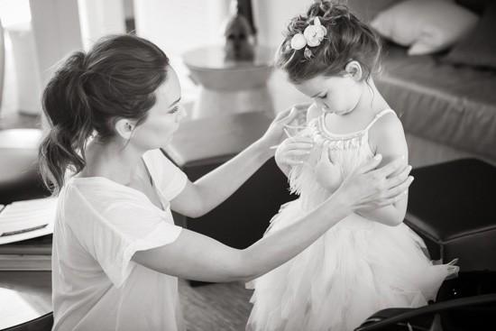 Bride helping flowergirl