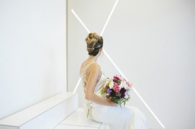 Bride in front of white wall
