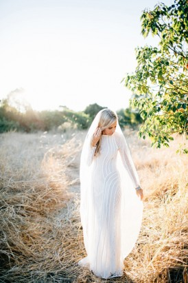 Bride in long sleeve bridal gown