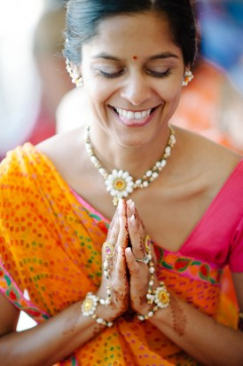 Bride praying in Indian wedding clothes