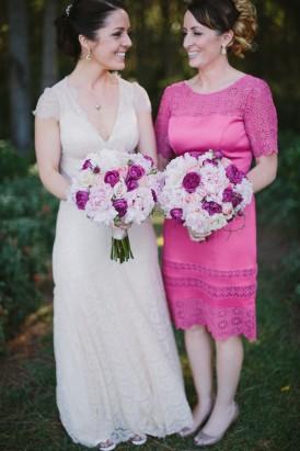 Bride with bridesmaid in hot pink