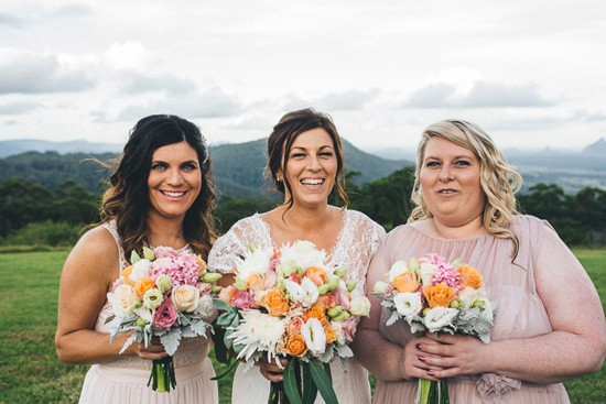 Bride with bridesmaids in pale pink
