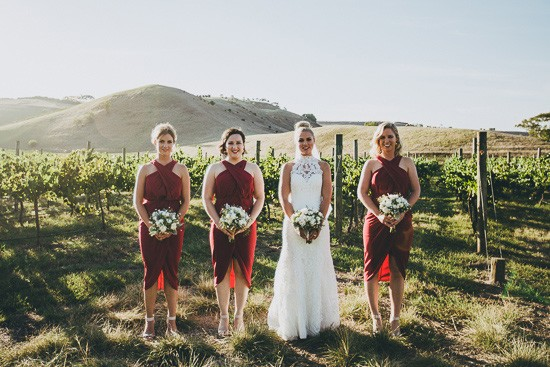 Bride with bridesmaids in red dresses