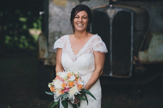 Bride with pink white and orange bouquet