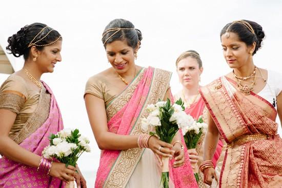 Bridesmaids in gold and pink saris