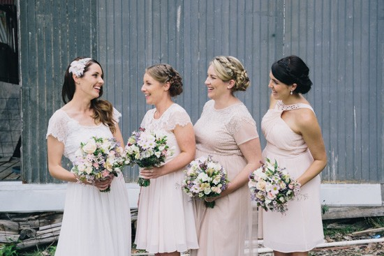 Bridesmaids in mismatched nude pink dresses