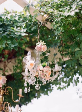 Crystal chandelier with peach roses