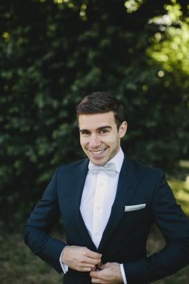 Dark navy suit with white tie
