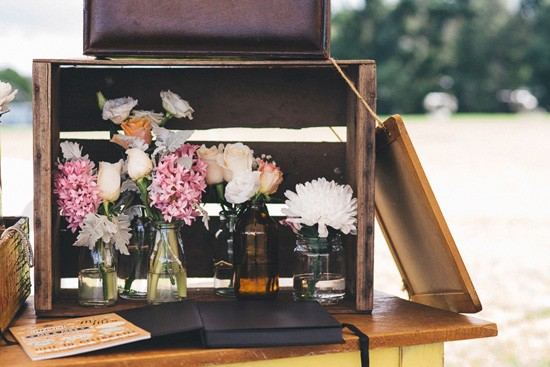 Floral arrangements in wooden boxes