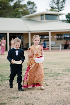 Flowergirl and pageboy walking down the aisle