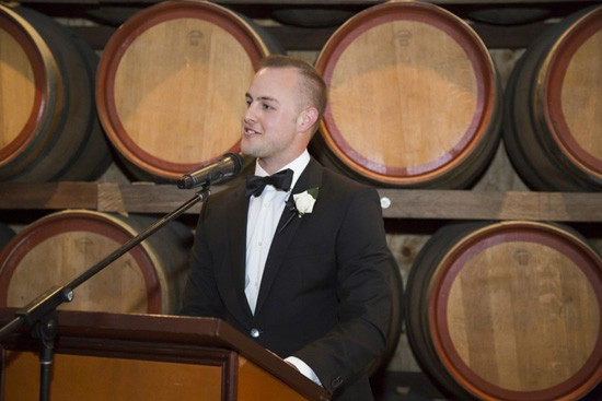 Giving speeches at winery wedding