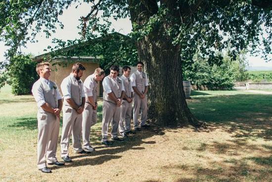 Groom and groomsmen in waistcoats and khaki pants