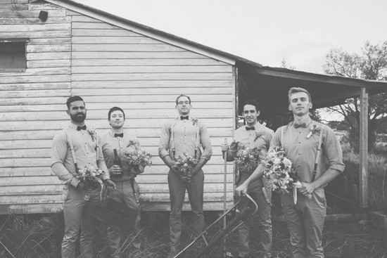 Groom and groomsmen with bouquets