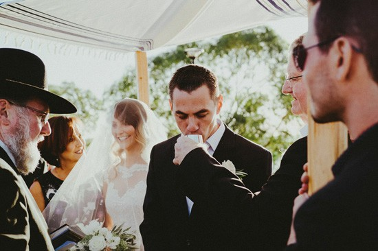 Groom drinking wine during wedding ceremony